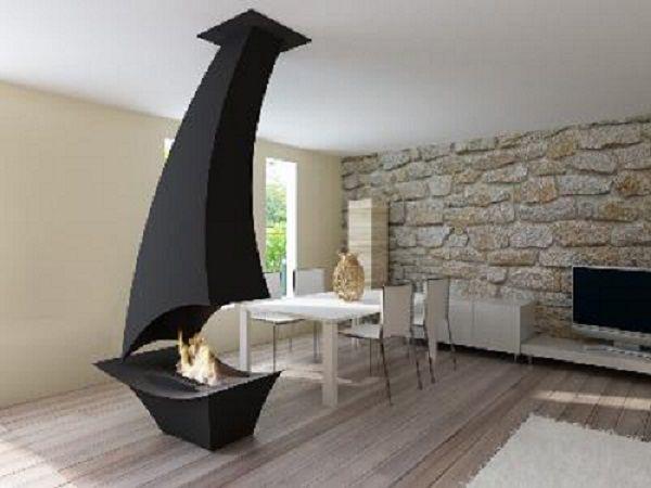 Caminetti Moderni Centrali : Camini sospesi e camini centrali: arte e riscaldamento